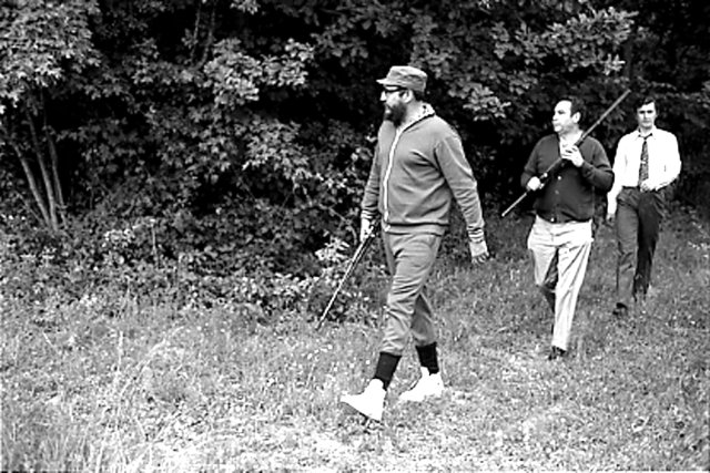 Fidel Castro (L) is seen during a hunting trip in Romania in this May 1972 file photo. REUTERS/Prensa Latina/File Photo