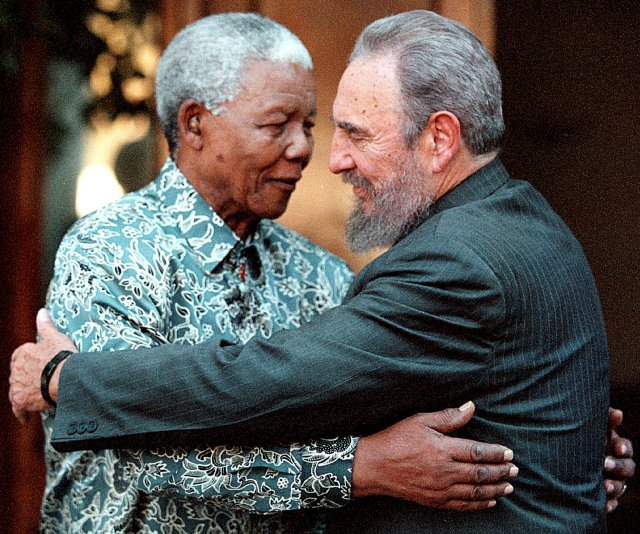 Former South African President Nelson Mandela (L) hugs Cuba's President Fidel Castro during a visit to Mandela's home in Houghton, Johannesburg in this September 2, 2001 file photo.  REUTERS/Chris Kotze/File Photo