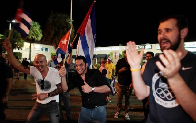 People celebrate after the announcement of the death of Cuban revolutionary leader Fidel Castro in the Little Havana district of Miami, Florida, U.S. November 26, 2016. REUTERS/Javier Galeano