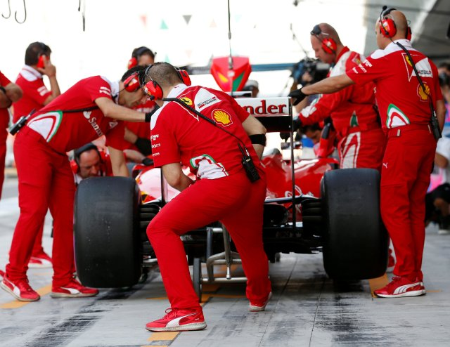 Formula One - F1 - Abu Dhabi Grand Prix - Yas Marina Circuit, Abu Dhabi, United Arab Emirates - 26/11/2016 - Ferrari's Formula One driver Sebastian Vettel of Germany stops at the pit lane during the third practice session. REUTERS/Ahmed Jadallah
