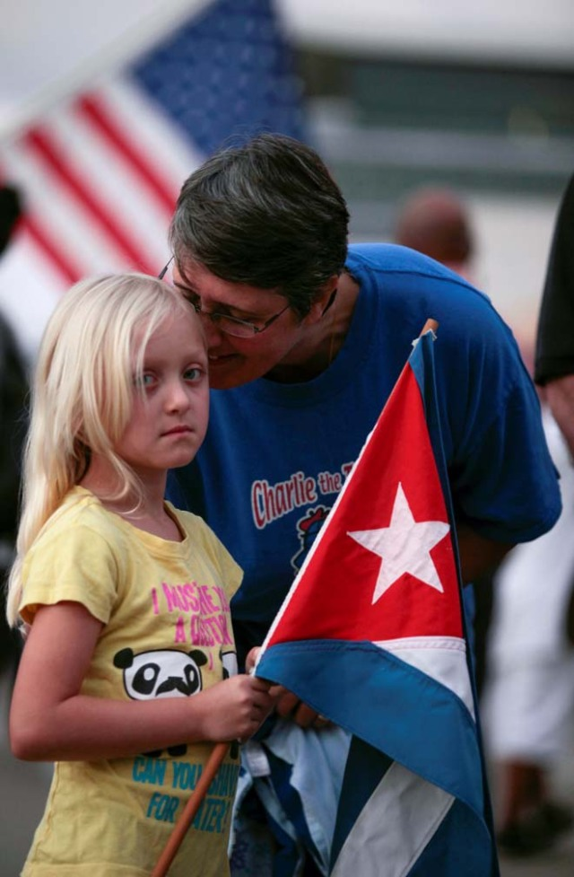 Cuban Margarita Aguilar kisses her grand-daughter Dylyn after the announcement of the death of Cuban revolutionary leader Fidel Castro in the Little Havana district of Miami, Florida, U.S. November 26, 2016. REUTERS/Javier Galeano
