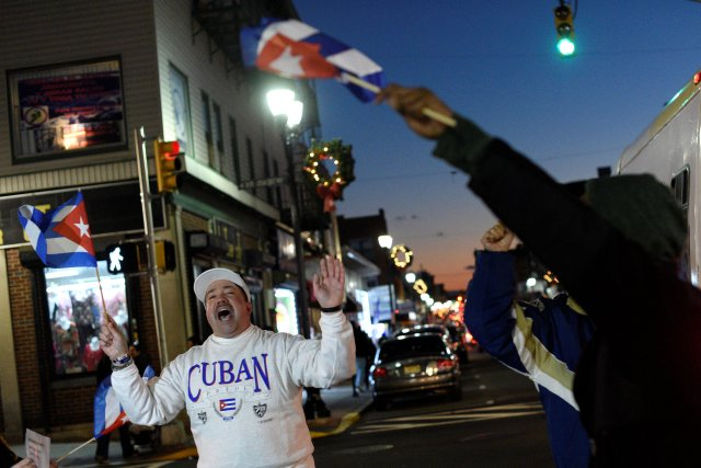 """People wave Cuban flags and shout """"Viva Cuba!"""" while celebrating the news of the death of  Cuban revolutionary leader Fidel Castro in Union City, New Jersey"""