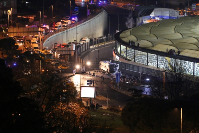 TURKEY OUT This photo obtained from photo agency Depo Photos shows fire fighters and police working at the site of a car bomb explosion outside the stadium of football club Besiktas in central Istanbul on December 10, 2016.   The car bomb exploded in the heart of Istanbul on late December 10, wounding around 20 police officers, Turkey's interior minister said, quoted by the official Anadolu news agency. The bomb, apparently targeting a bus carrying police officers, exploded outside the stadium of Istanbul football club Besiktas following its match against Bursaspor.  / AFP PHOTO / DEPO PHOTOS / Goktay KORALTAN / Turkey OUT