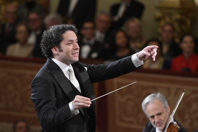 Venezulean conductor Gustavo Dudamel conducts the traditional New Year's Concert 2017 with the Vienna Philharmonic Orchestra at the Vienna Musikverein in Vienna, Austria, on January 1, 2017. / AFP PHOTO / APA / HERBERT NEUBAUER / Austria OUT