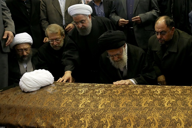 Iran's Supreme Leader Ayatollah Ali Khamenei and Iran's President Hassan Rouhani touch the coffin of former president Ali Akbar Hashemi Rafsanjani during his funeral ceremony in Tehran, Iran January 10, 2017. Leader.ir/Handout via REUTERS ATTENTION EDITORS - THIS IMAGE WAS PROVIDED BY A THIRD PARTY. EDITORIAL USE ONLY. NO RESALES. NO ARCHIVE.