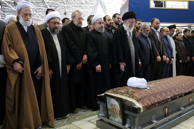 Iran's Supreme Leader Ayatollah Ali Khamenei and Iran's President Hassan Rouhani pray next to the coffin of former president Ali Akbar Hashemi Rafsanjani during his funeral ceremony in Tehran, Iran January 10, 2017. President.ir/Handout via REUTERS ATTENTION EDITORS - THIS PICTURE WAS PROVIDED BY A THIRD PARTY. FOR EDITORIAL USE ONLY. NO RESALES. NO ARCHIVE.