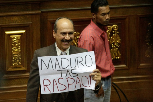 "A deputy of the Venezuelan coalition of opposition parties (MUD) holds a placard that reads ""Maduro you have failed"" during a session of the National Assembly in Caracas, Venezuela January 9, 2017. REUTERS/Marco Bello"