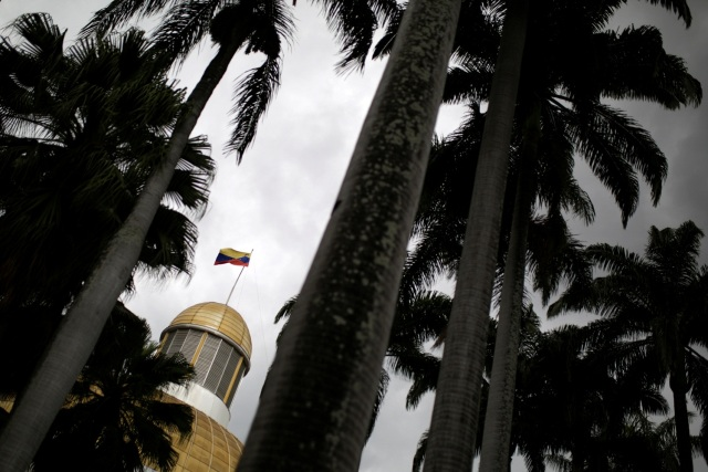 The Venezuelan national flag is seen atop the building housing the National Assembly in Caracas, Venezuela January 9, 2017. REUTERS/Marco Bello
