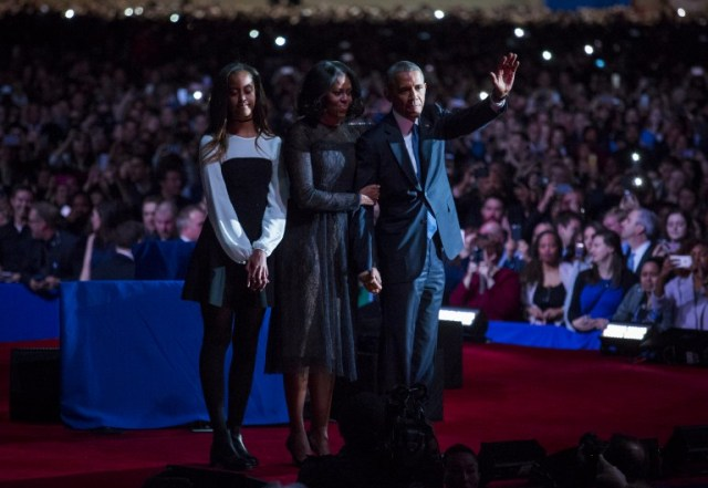 CHICAGO, IL - JANUARY 10: U.S. President Barack Obama, first lady Michelle Obama and daughter Malia Obama wave goodbye to supporters after Obama's farewell address at McCormick Place on January 10, 2017 in Chicago, Illinois. Obama addressed the nation in what is expected to be his last trip outside Washington as president. President-elect Donald Trump will be sworn in as the 45th president on January 20. Darren Hauck/Getty Images/AFP