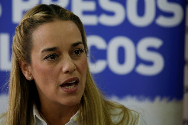 Lilian Tintori, wife of jailed Venezuelan opposition leader Leopoldo Lopez, speaks during a news conference in Caracas
