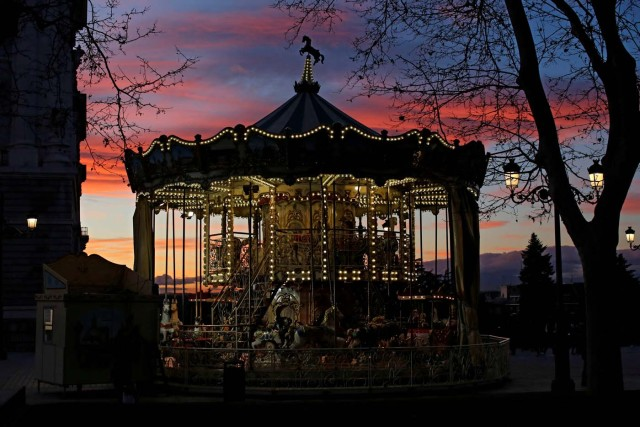 A carousel is seen outside the Royal Palace in Madrid, Spain January 16, 2017. REUTERS/Juan Medina