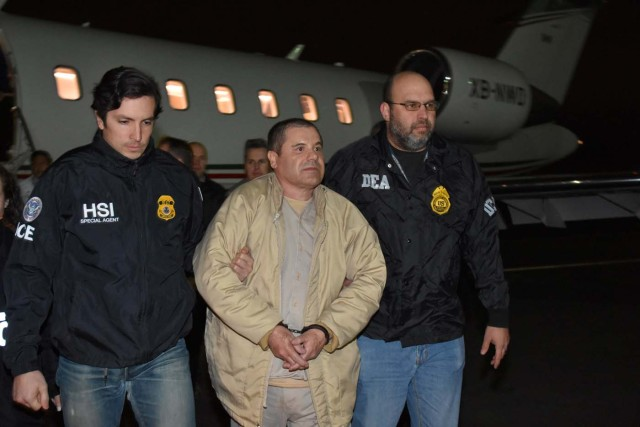 """Mexico's top drug lord Joaquin """"El Chapo"""" Guzman is escorted as he arrives at Long Island MacArthur airport in New York, U.S., January 19, 2017, after his extradition from Mexico. U.S. officials/Handout via REUTERS      ATTENTION EDITORS - THIS IMAGE WAS PROVIDED BY A THIRD PARTY. EDITORIAL USE ONLY.     TPX IMAGES OF THE DAY"""