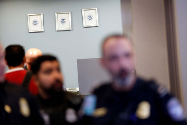 Picture frames, which formerly held portraits of officials including the President of the United States, hang empty with only a Department of Homeland Security seal in the U.S. Customs and Border Protection office during the travel ban at Los Angeles International Airport (LAX) in Los Angeles, California, U.S., January 28, 2017. REUTERS/Patrick T. Fallon
