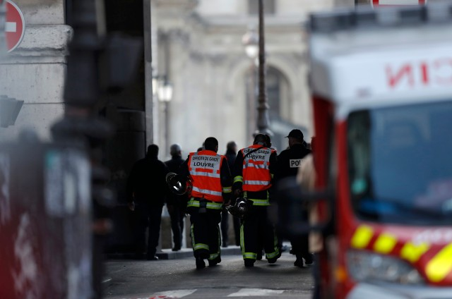 French firefighters and police are seen at the site near the Louvre Pyramid in Paris, France, February 3, 2017 after a French soldier shot and wounded a man armed with a knife after he tried to enter the Louvre museum in central Paris carrying a suitcase, police sources said. REUTERS/Christian Hartmann
