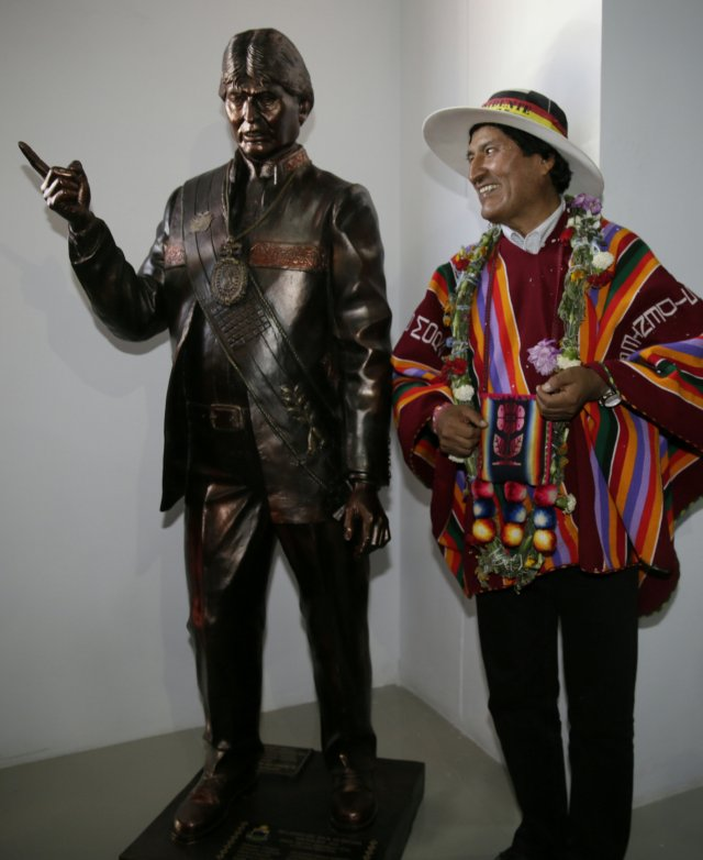 Bolivia's President Evo Morales poses with a statue of himself after the inauguration of the Orinoca Museum in Orinoca