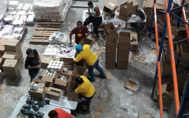 Operación de llenado de cajas CLAP en un galpón en la Zona Libre de Colón en Panamá / lapatilla.com