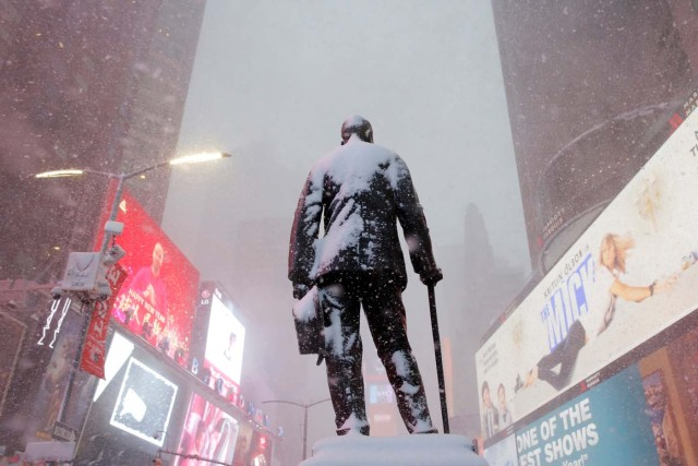 A statue of American composer, playwright, actor, and producer George M. Cohan stands in Times Square as snow falls in Manhattan, New York, U.S. February 9, 2017. REUTERS/Andrew Kelly