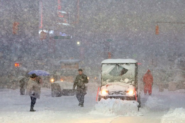 A snowplow drives through Times Square as snow falls in Manhattan, New York, U.S. February 9, 2017. REUTERS/Andrew Kelly