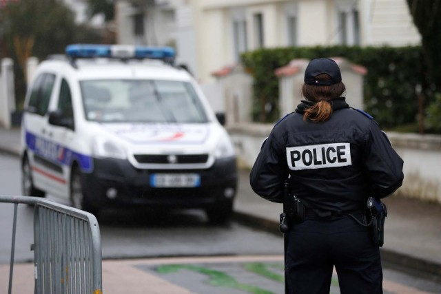 French police secure the streets around the house of the Troadec family in Orvault near Nantes, France, March 1, 2017. The couple and their two children have been missing for nearly two weeks. REUTERS/Stephane Mahe