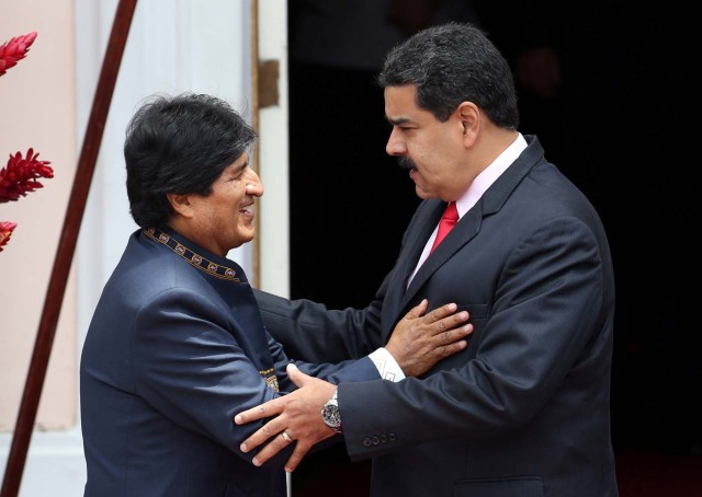 Venezuela's President Nicolas Maduro (R) speaks to Bolivia's President Evo Morales during the welcoming ceremony of an ALBA alliance summit to mark fourth anniversary of the death of Venezuela's late President Hugo Chavez in Caracas, Venezuela, March 5, 2017. REUTERS/Carlos Garcia Rawlins