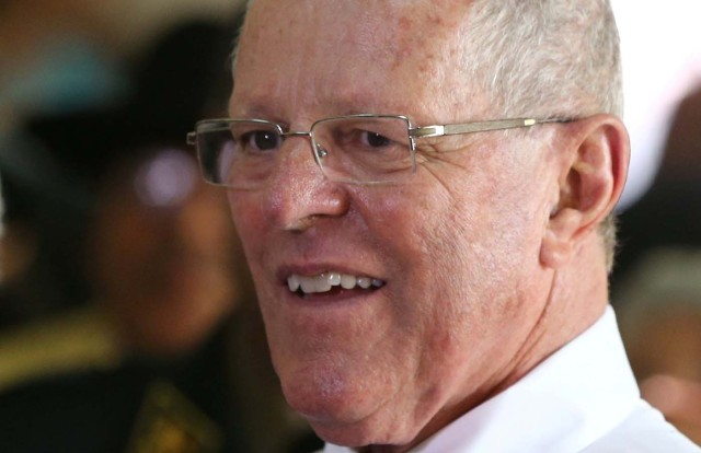 "FILE PHOTO - Peru's President Pedro Pablo Kuczynski visits the home for elderly ""Hermanitas de Los Desamparados"" to celebrate Christmas in Lima, Peru, December 19, 2016. REUTERS/Mariana Bazo/File Photo"