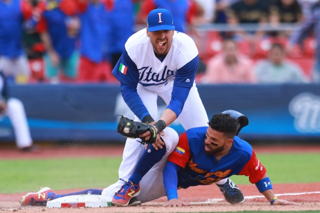 ZAPOPAN, MEXICO - MARCH 11: Jose Altuve #27 of Venezuela slides into third base to score in the top of the seventh inning during the World Baseball Classic Pool D Game 3 between Venezuela and Italy at Panamericano Stadium on March 11, 2017 in Zapopan, Mexico. Miguel Tovar/Getty Images/AFP