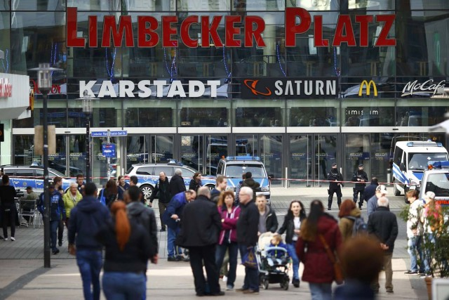 Police at the entrance of Limbecker Platz shopping mall in Essen, Germany, March 11, 2017, after it was shut due to attack threat. REUTERS/Thilo Schmuelgen