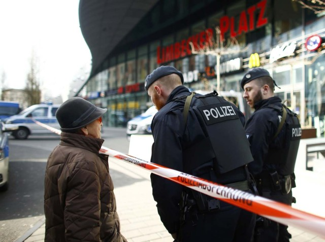 Police talk to a woman at the entrance of Limbecker Platz shopping mall in Essen, Germany, March 11, 2017, after it was shut due to attack threat. REUTERS/Thilo Schmuelgen