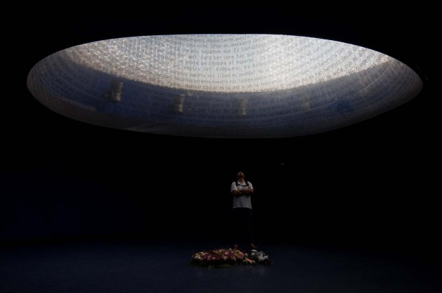 A man looks up at the Madrid train bombing memorial on the 13th anniversary of the attacks at Atocha station in Madrid, Spain, March 11, 2017. REUTERS/Sergio Perez