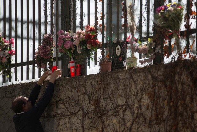 A man places candles at the same spot a train was bombed in the 2004 Madrid train bombings, at a memorial site for the victims of the bombings, near Atocha station in Madrid, Spain, March 11, 2017. REUTERS/Sergio Perez