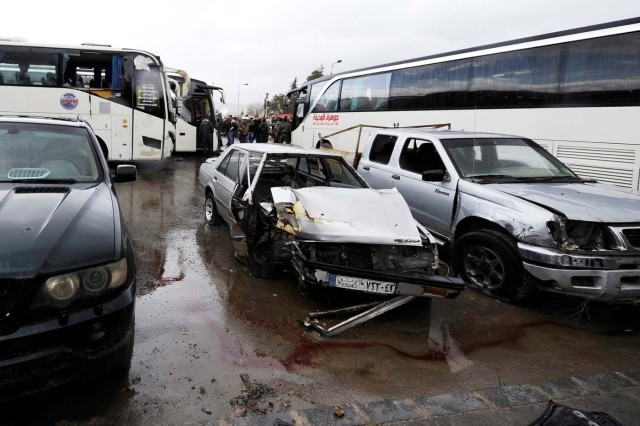 Damaged vehicles are pictured at the site of an attack by two suicide bombers in Damascus, Syria March 11, 2017. REUTERS/Omar Sanadiki