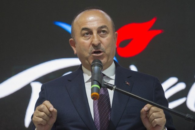 "Turkish Foreign Minister Mevlut Cavusoglu delivers a speech during his visit to his country's hall at the Internationale Tourismus-Boerse (ITB) international travel trade show in Berlin on March 8, 2017. Cavusoglu said he expected to host his German counterpart Sigmar Gabriel ""as soon as possible,"" as the NATO allies struggle to end a bad-tempered row. / AFP PHOTO / STEFFI LOOS"