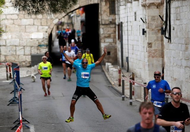 Athletes run inside Jerusalem's Old City during the seventh International Jerusalem Marathon March 17, 2017. REUTERS/Ronen Zvulun