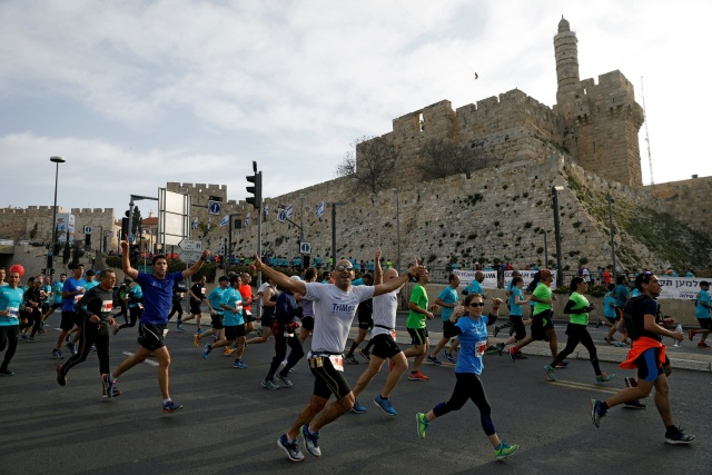 Athletes run outside Jerusalem's Old City during the seventh International Jerusalem Marathon March 17, 2017. REUTERS/Ronen Zvulun