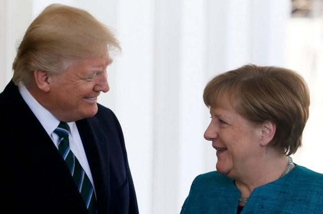 U.S. President Donald Trump greets German Chancellor Angela Merkel at the White House in Washington, U.S., March 17, 2017. REUTERS/Jim Bourg