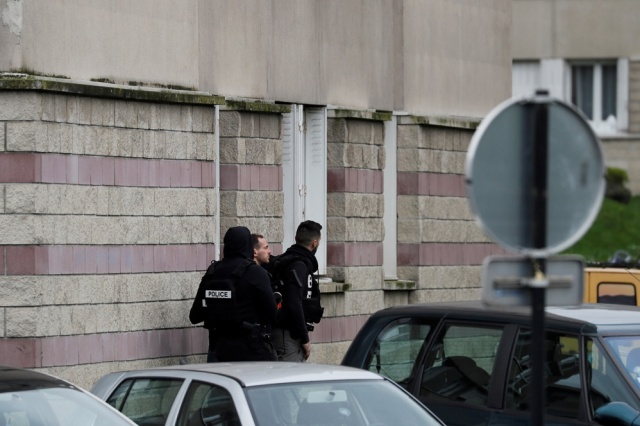 Police officers investigate at the house of the suspect of an attack at the Paris Orly's airport, on March 18, 2017 in Garges-les-Gonesse. A man who had been investigated for links to radical Islam was shot dead at Orly airport south of Paris on today after attacking a soldier on patrol and trying to grab her rifle. The same man is suspected of having shot at police earlier in the day, leaving an officer with minor wounds after being pulled over while driving in a suburb north of the French capital.  / AFP PHOTO / THOMAS SAMSON