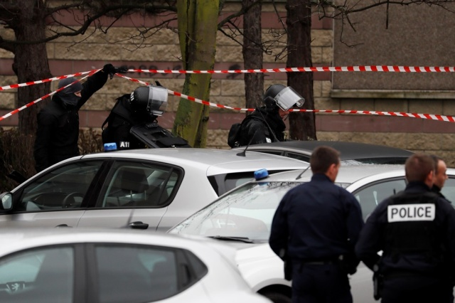 Police officers and RAID police unit officers investigate at the house of the suspect of an attack at the Paris Orly's airport, on March 18, 2017 in Garges-les-Gonesse. A man who had been investigated for links to radical Islam was shot dead at Orly airport south of Paris on today after attacking a soldier on patrol and trying to grab her rifle. The same man is suspected of having shot at police earlier in the day, leaving an officer with minor wounds after being pulled over while driving in a suburb north of the French capital.  / AFP PHOTO / THOMAS SAMSON