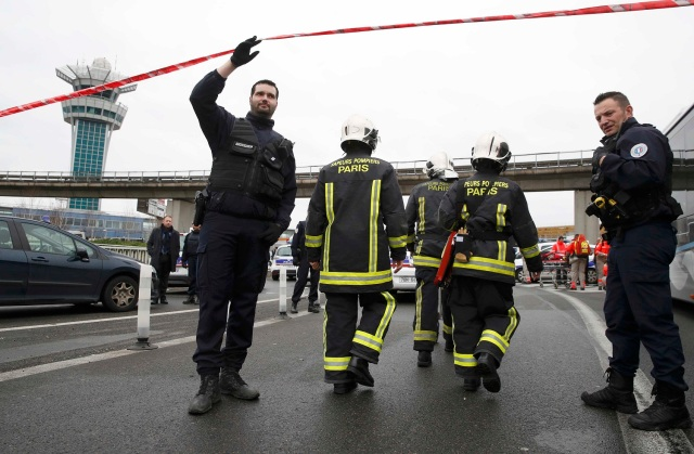Emergency services arrive at Orly airport southern terminal after a shooting incident near Paris, France March 18, 2017. REUTERS/Christian Hartmann