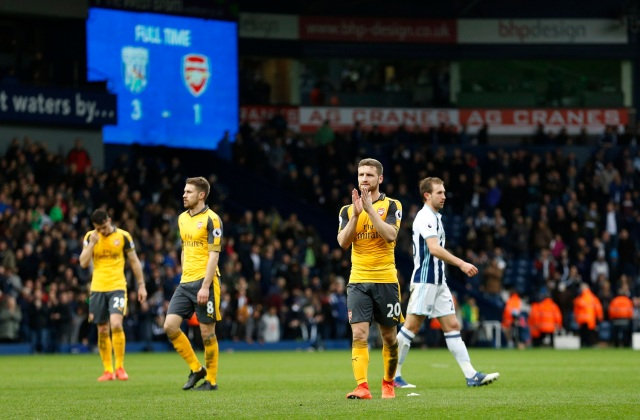 """Britain Football Soccer - West Bromwich Albion v Arsenal - Premier League - The Hawthorns - 18/3/17 Arsenal's Shkodran Mustafi applauds fans after the match Action Images via Reuters / Andrew Boyers Livepic EDITORIAL USE ONLY. No use with unauthorized audio, video, data, fixture lists, club/league logos or """"live"""" services. Online in-match use limited to 45 images, no video emulation. No use in betting, games or single club/league/player publications. Please contact your account representative for further details."""