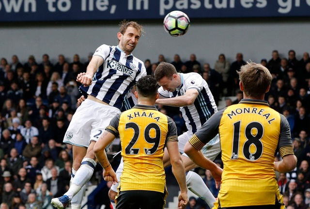 """Britain Football Soccer - West Bromwich Albion v Arsenal - Premier League - The Hawthorns - 18/3/17 West Bromwich Albion's Craig Dawson scores their third goal Reuters / Darren Staples Livepic EDITORIAL USE ONLY. No use with unauthorized audio, video, data, fixture lists, club/league logos or """"live"""" services. Online in-match use limited to 45 images, no video emulation. No use in betting, games or single club/league/player publications. Please contact your account representative for further details."""