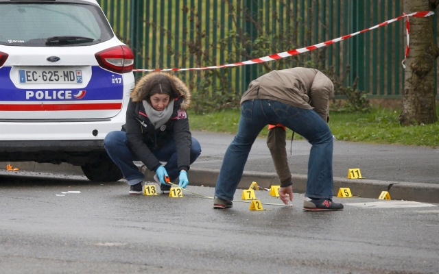 Police investigators at the scene of a shooting near the northern Paris suburb of Stains, France, March 18, 2017. REUTERS/Charles Platiau