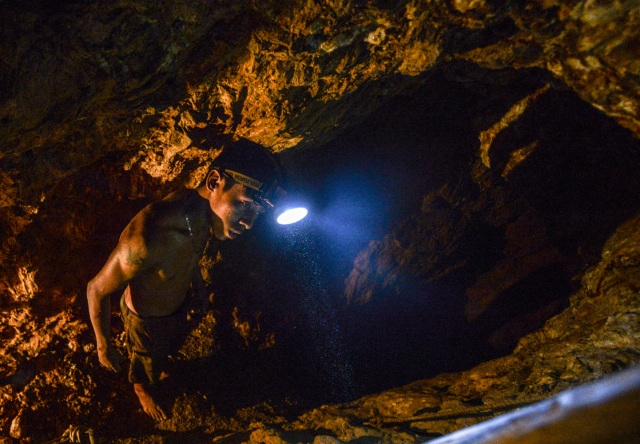 Ender Moreno looks for gold at La Culebra gold mine in El Callao, Bolivar state, southeastern Venezuela on March 1, 2017. Although life in the mines of eastern Venezuela is hard and dangerous, tens of thousands from all over the country head for the mines daily in overcrowded trucks, pushed by the rise in gold prices and by the severe economic crisis affecting the country, aggravated recently by the drop in oil prices. / AFP PHOTO / JUAN BARRETO / TO GO WITH AFP STORY by Maria Isabel SANCHEZ