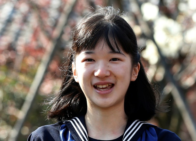 Japan's Princess Aiko smiles as she attends her graduation ceremony at the Gakushuin Girls' Junior High School in Tokyo, Japan, March 22, 2017. REUTERS/Issei Kato