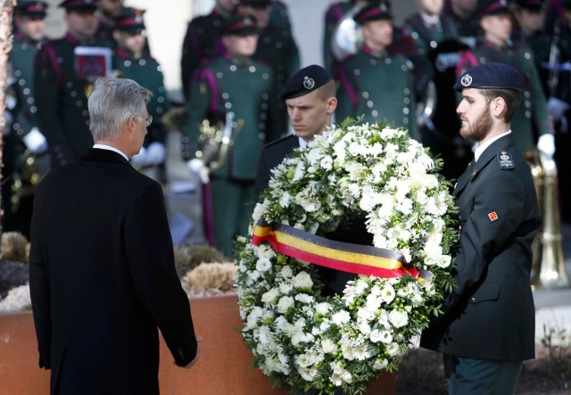 Belgium's King Philippe lays a wreath during a ceremony in Brussels to commemorate the first anniversary of twin attacks at Brussels airport and a metro train in Brussels, Belgium, March 22, 2017. REUTERS/Yves Herman