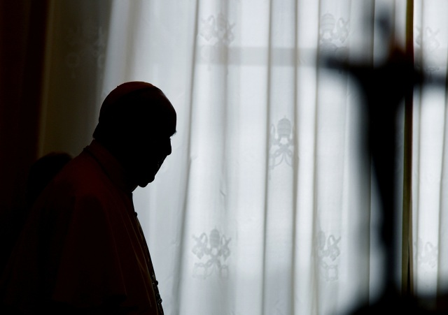 Pope Francis is silhouetted at the end of a private audience with Cameroon's President Paul Biya at the Vatican March 23, 2017. REUTERS/Vincenzo Pinto/pool