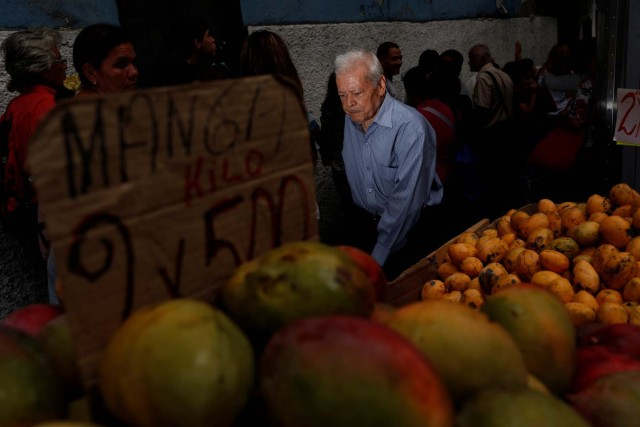 "A man walks past people queueing to try and buy food outside a supermarket in Caracas, Venezuela May 23, 2016. REUTERS/Carlos Garcia Rawlins     SEARCH ""GARCIA QUEUEING"" FOR THIS STORY. SEARCH ""WIDER IMAGE"" FOR ALL STORIES."