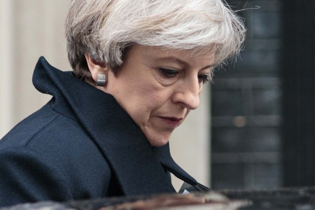 British Prime Minister Theresa May leaves 10 Downing Street in central London on March 23, 2017.  Britain's parliament reopened on Thursday with a minute's silence in a gesture of defiance a day after an attacker sowed terror in the heart of Westminster, killing three people before being shot dead. Sombre-looking lawmakers in a packed House of Commons chamber bowed their heads and police officers also marked the silence standing outside the headquarters of London's Metropolitan Police nearby.  / AFP PHOTO / POOL / Jack Taylor