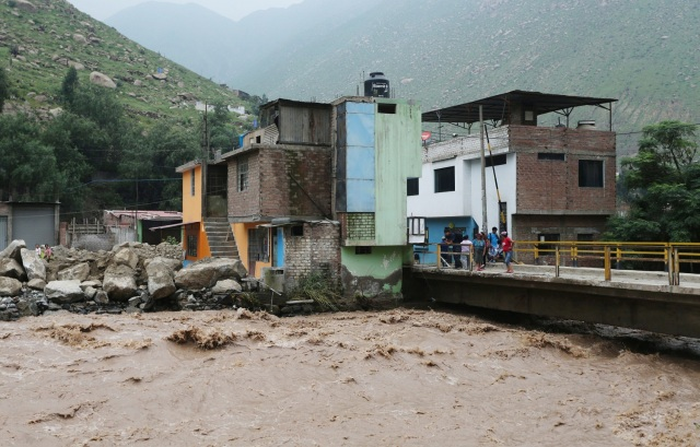 View of flooded homes after the Rimac river overflowed near the Central Highway in Huarochiri, Lima, Peru, March 23, 2017. REUTERS/Guadalupe Pardo