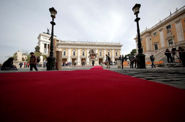 "Workers lay a red carpet in front of the city hall ""Campidoglio"" (the Capitoline hill) as preparation for the meeting of EU leaders on the 60th anniversary of the Treaty of Rome, in Rome, Italy March 24, 2017. REUTERS/Alessandro Bianchi"