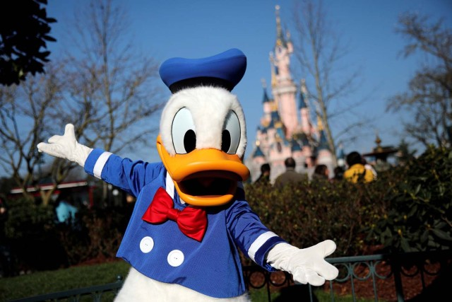 Disney character Donald Duck poses for photos in Disneyland Paris ahead of the 25th anniversary of the park in Marne-la-Vallee, near Paris, France, March 16, 2017. Picture taken March 16, 2017. REUTERS/Benoit Tessier